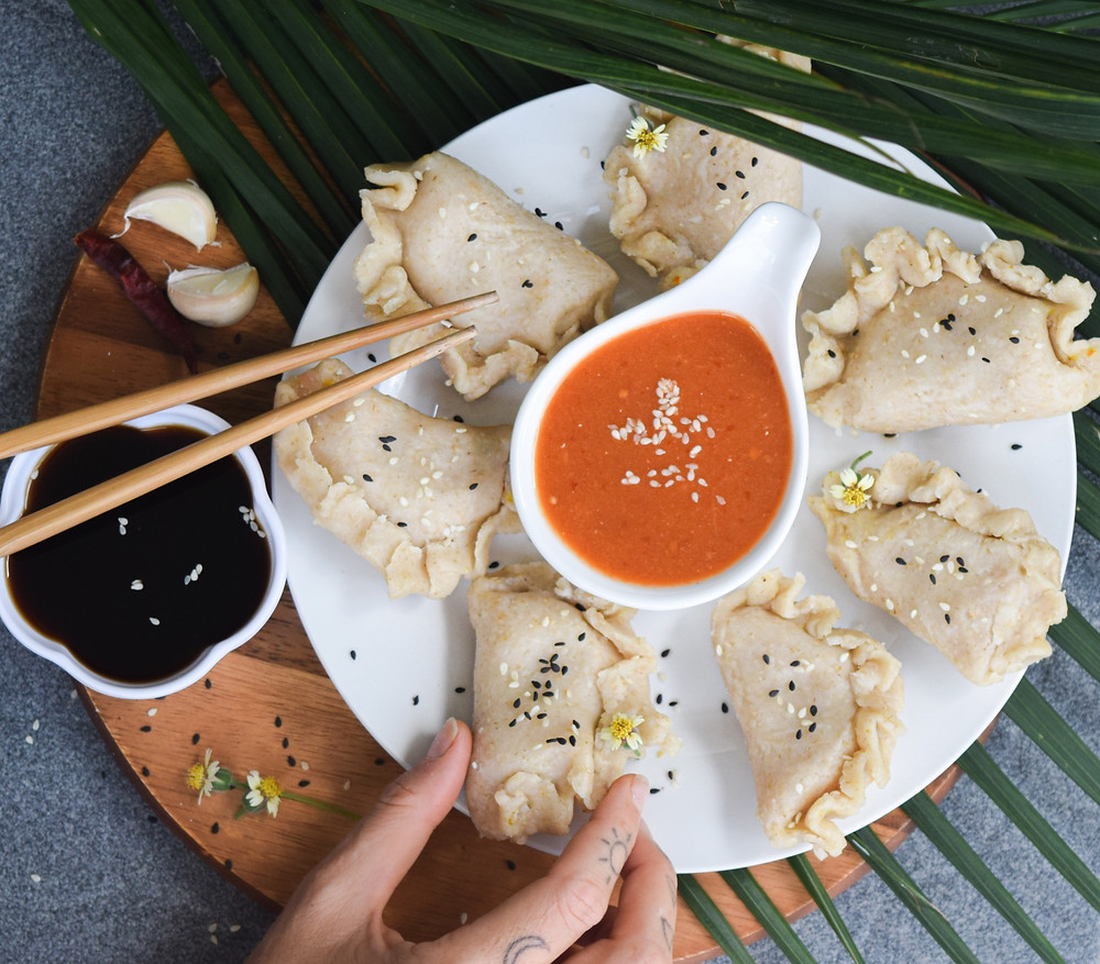 Vegan and gluten-free steamed momos! A dish inspired by my time traveling in Nepal. These momos are similar to dumplings - filled with a tofu and vegetable mixture. It's a filling and tasty main dish or share among friends. Dip in this sweet and spicy tomato chutney (recipe included) or tamari sauce! Your body will thank you for this gluten-free alternative without losing the love of traditional momos.