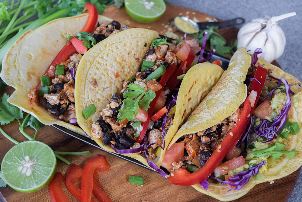 Taco Tuesday - or any day of the week deliciousness - enjoy these heathy, vegan, gluten-free tacos! Make the tortillas, tofu 'taco meat' and toppings in less than 30 minutes! This easy plant-based meal is about to become a go-to favorite! Homemake the simple 5 ingredient, gluten-free tortillas in minutes! Fill your taco with all your favorite veggies and this tofu 'taco meat' recipe! I use wholesome and fresh ingredients to optimize your health and feed your soul! These tacos are filling and satisfying.
