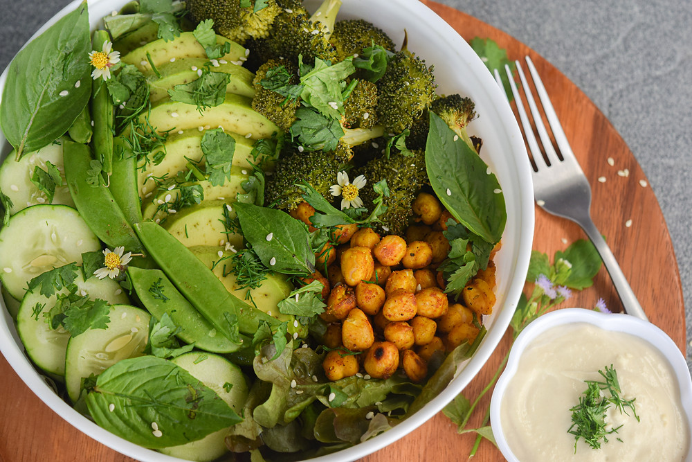 Try this simple and easy, vegan and gluten-free salad recipe! It's a delicious green goddess bowl that will leave you feeling full and satisfied. Yes - salad can be THIS good! Loaded with roasted broccoli, spiced chickpeas, avocado, snap peas, cucumber, fresh herbs... It's the perfect balance of raw and baked food for a fresh and comforting feeling.