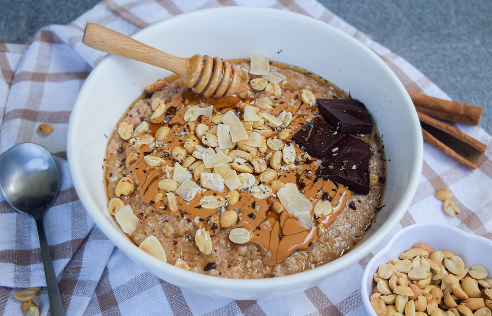 Take your plant-based morning oat bowl to the next level - make it a snickers bowl! Prepare a bowl of warm and comforting oats with coconut milk & spices like cinnamon and vanilla. Add cacao powder for your chocolatey fix! Decorate with your favorite toppings like nut butter, peanuts, coconut, and do I dare say- more chocolate! This vegan and gluten-free breakfast is sure to keep your filling full and fueled for your days routines!