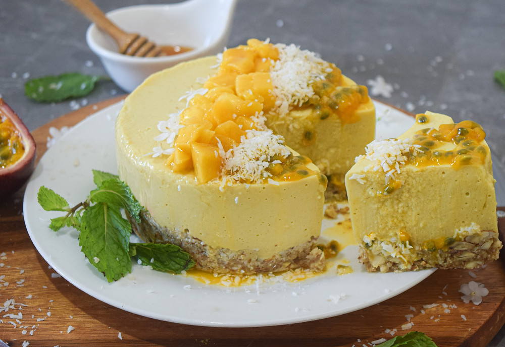 Vegan mango cheese cake recipe- a healthy & delicious indulgence! This plant-based cheese cake is simple and easy, do I even need to mention it tastes amazing! It's light and refreshing but completely satisfies your sweet tooth. It's a summery, tropical dessert with a vibrant color. The cake's radiance reflects it's high energetic frequency. I use clean ingredients to encourage overall health and happiness!