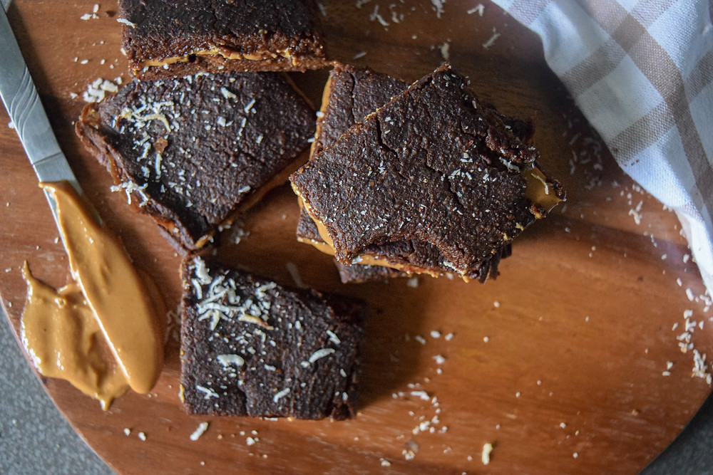 These vegan, gluten-free brownies are not just delicious, chocolatey and moist but healthy. Make a nut butter layer for an extra irresistible bite. Made with pumpkin, cacao powder, coconut milk, almond flour, tapioca powder... These pumpkin & peanut butter brownies satisfy your sweet tooth without compromising your health! Enjoy guilt free!
