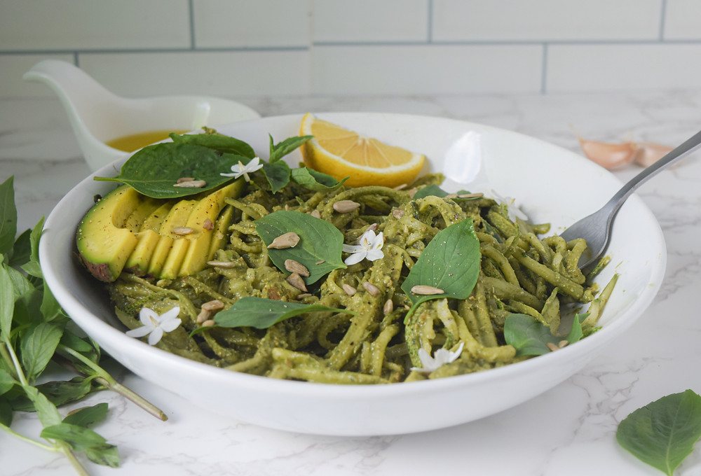 Cucumber noodles take just 10 minutes to make, are crunchy, nutritious, and delicious! Toss with a simple and quick blended avocado, pesto for a burst of flavor! Enjoy this raw-vegan, nut-free pasta dish guilt-free! It's a plant-based meal that takes no time at all and serves your overall health - mind, body & spirit!