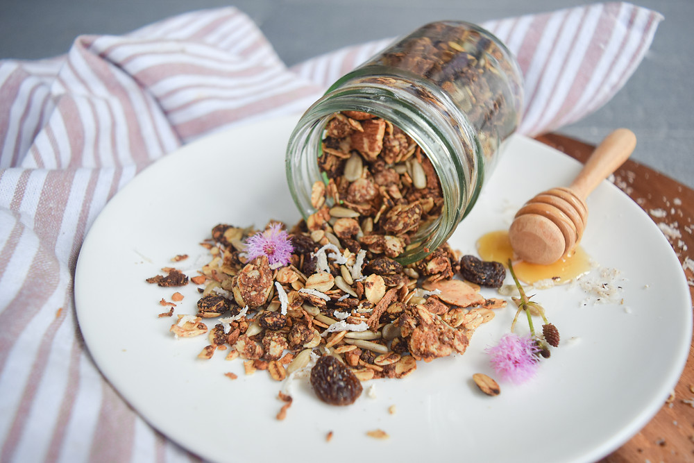This vegan, gluten-free granola recipe uses simple and wholesome ingredients. It's easy to make and offers more health benefits than store bought granolas (that are often loaded with sugars). This warming and nutty granola goes great on top of your smoothies, papaya boats, chia puddings, or served with fresh fruit and nut-milk. Make a batch and store it for weekly breakfast, snacks or dessert toppings!