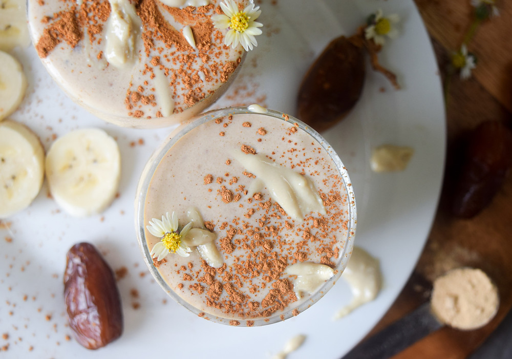 Rise and shine with a delicious tahini smoothie! A perfect blend of bananas, coconut milk, tahini, dates, cinnamon and maca - YUM! It's a plant-based breakfast that you must try! Not only is it delicious and filling, I use whole, real and fresh ingredients to serve you optimum nutrition. This vegan tahini shake is sure to take a spot on your weekly morning menu. It's a perfect healthy choice for your busy mornings when you need a quick and easy, grab-and-go, breakfast!