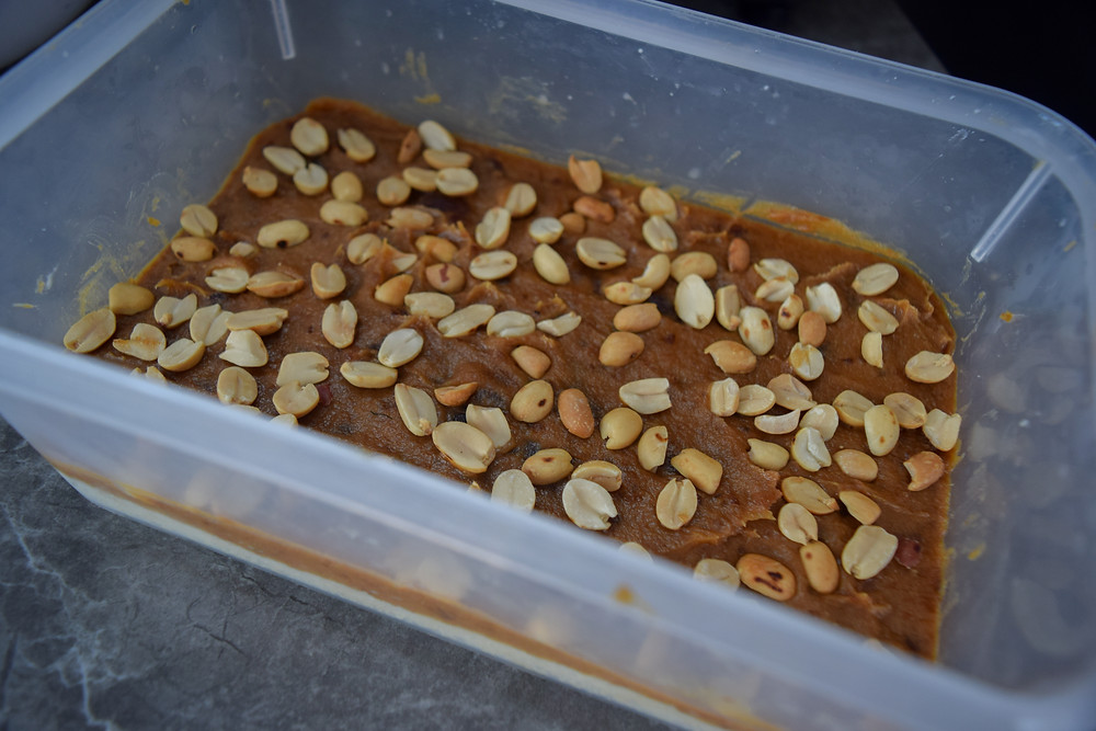 Healthy, homemade 'Snickers bars'! It's better than the original - I guarantee it! This vegan and gluten-free dessert is sure to satisfy all your chocolatey and peanut buttery cravings! It uses simple and wholesome ingredients to create a guilt free indulgence. A bottom crust layer, caramel layer, crunchy peanuts, and chocolate to coat - YUM! Store these plant-based snickers in your freezer to have available for your next sweet treat! Oh - and there is no age limitation for loving this candy bar!