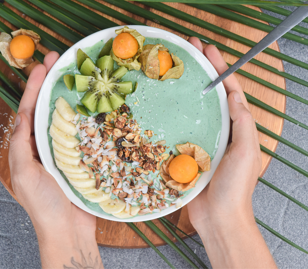 This vibrant banana smoothie bowl is made with just 4 simple ingredients! Decorate with your favorite toppings like fresh fruit, coconut shreds, homemade granola, etc. to complete your breakfast feast! This healthy 10 minute breakfast will have you feeling full and satisfied throughout your morning routines!