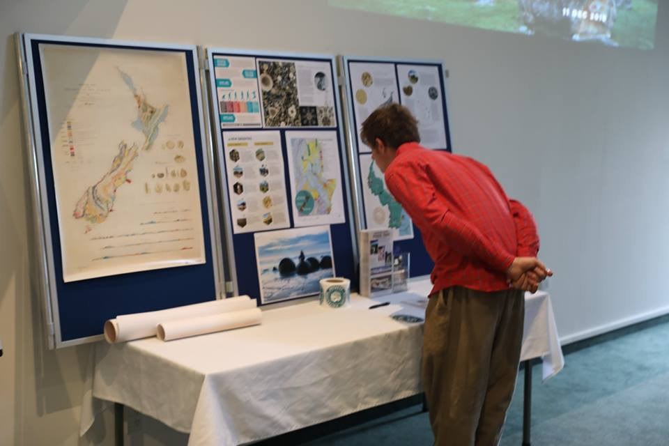 Person looking at Geopark posters