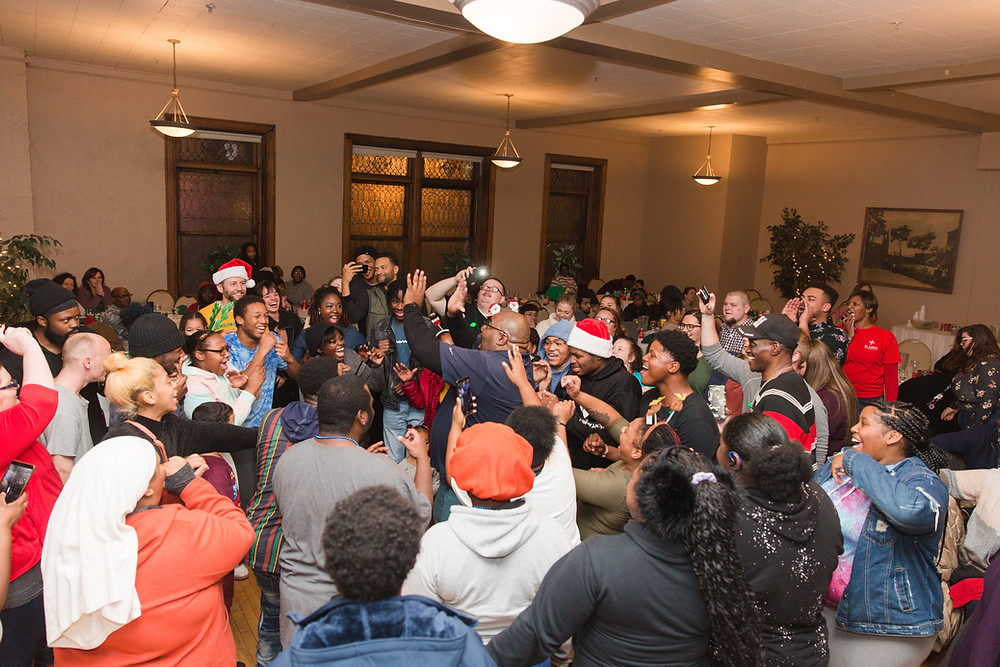 Youth and staff celebrate during 2019's Outreach Holiday Party