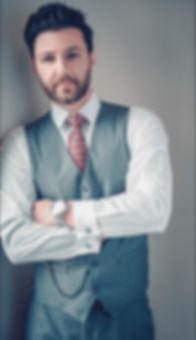 ben against wall vest.jpg