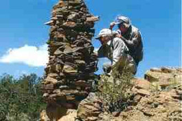 This large sheepherder's cairn, approximately 6 feet tall, is a construction from the historic sheepherding era. Four rocks sticking out from near the top of the cairn mark the four directions.  Site Stewards monitor this site to insure that the cairn remains stable.