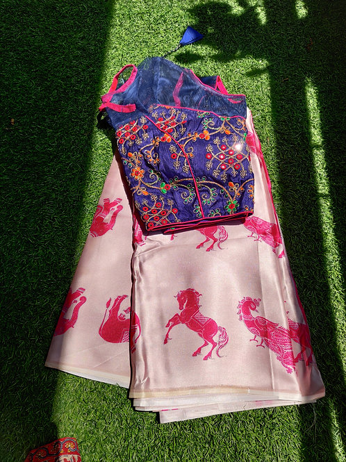 Pink animal print saree with blue ready made heavy work blouse