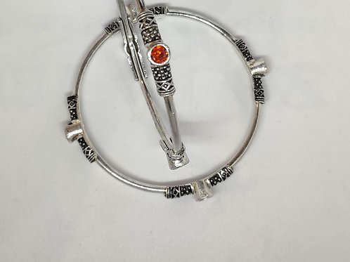 Silver bangles with stones