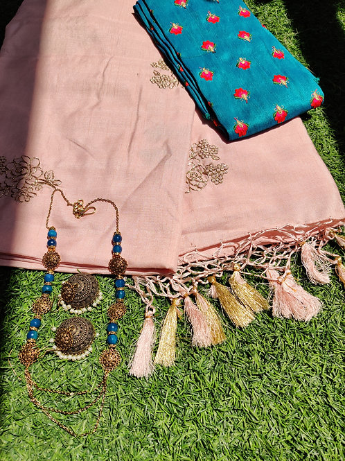 Baby pink embroidery saree with contrast blue blouse and blue set