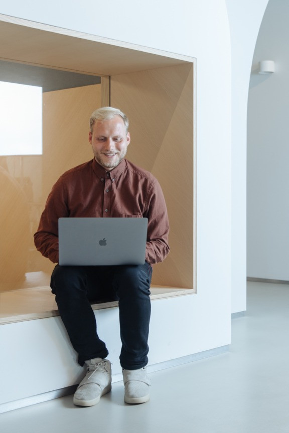 A Wix employee from Vilnius with laptop
