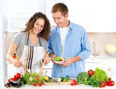 Happy couple preparing healthy meal.