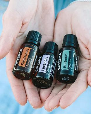 doTERRA-essential-oils-bottles-in-womans