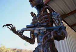Alien holding a Marksman
