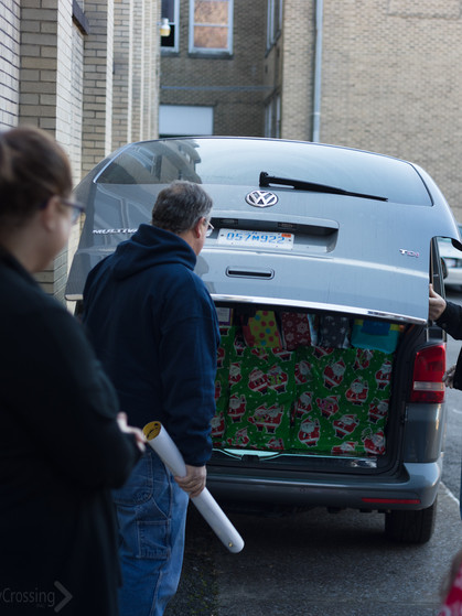 Unloading the gifts donated by Norwalk Antique Car Club!