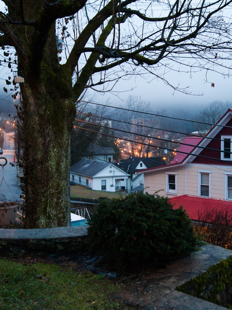 Fog rolled in over the hills and filled the sky in Welch.