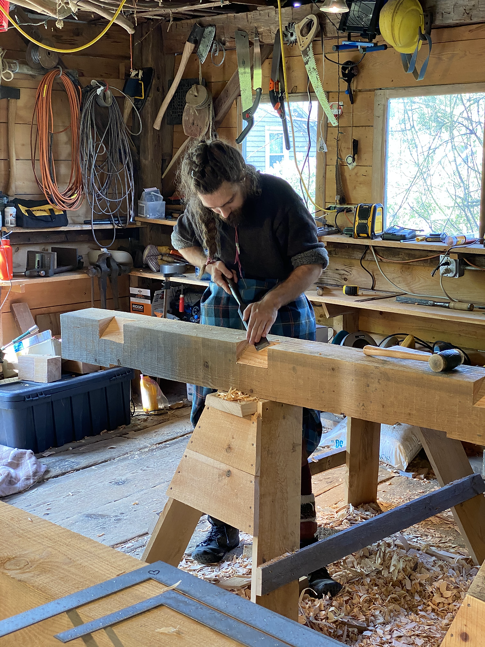 Stephen cutting a rafter pocket on the plate beam.