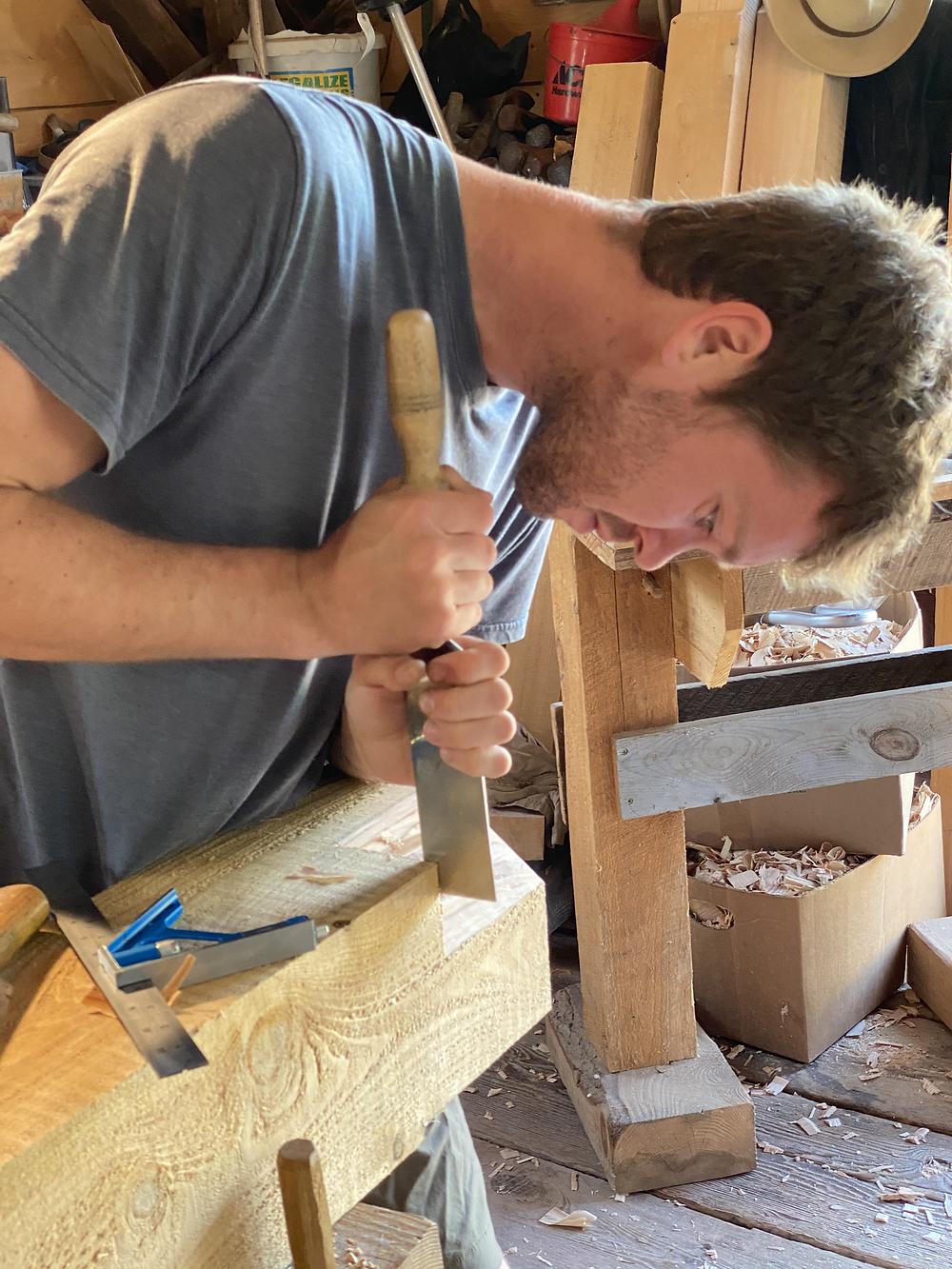 Justin cuts a rafter pocket