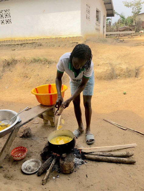 A young woman in Margibi making plantain chips to sell.