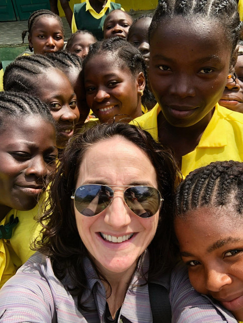 Margo Rees with some beautiful school girls in Nimba County