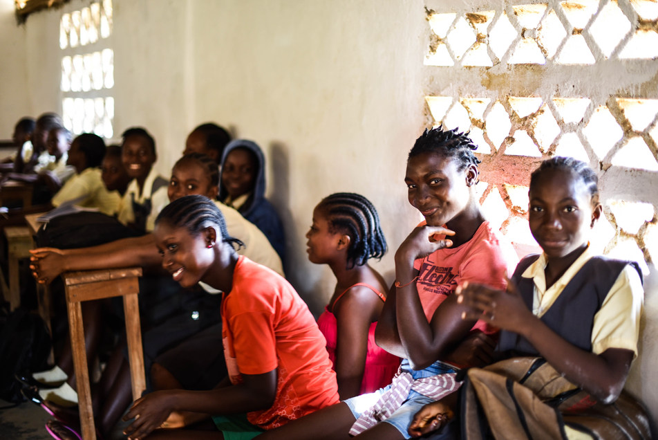 School girls in Grand Bassa, Liberia, learn about how to report and prevent sexual harassment and gender-based violence