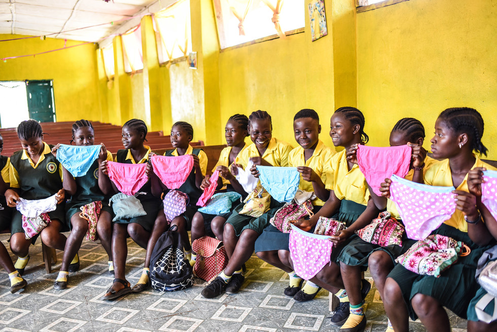 School girls in Foequelleh, Liberia learn about their new sustainable Feminine Hygiene Kits
