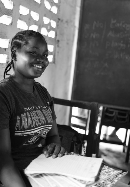 A young teacher at Smart Academy School in Paynesville.