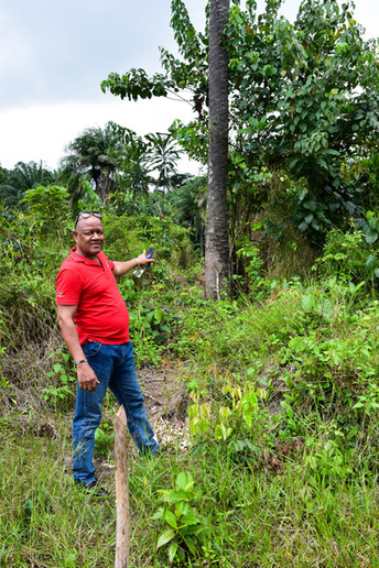 Owen Dunbar, our local partner, standing on the future site of Lydia House in Bong County.