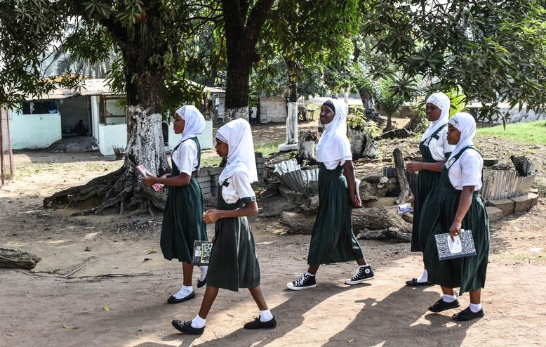 Some Muslim girls from a neighboring school join Smart Academy girls to receive Feminine Hygiene Kits