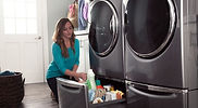 girl with washer and dryer.jpg