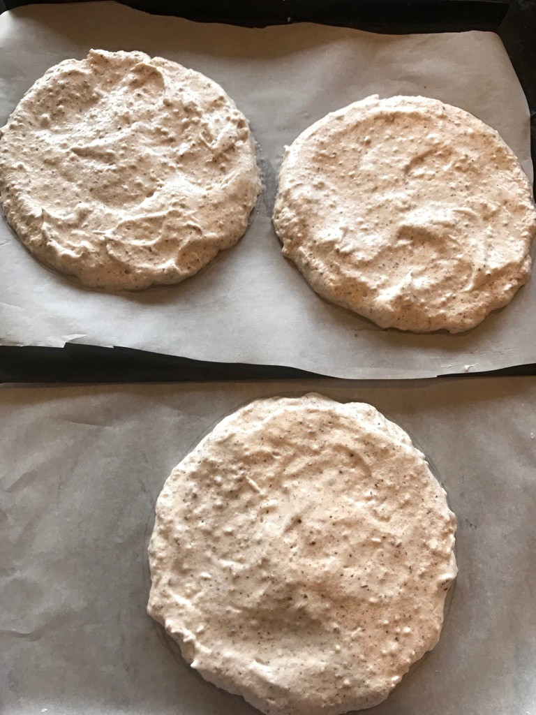 Adding Hazelnut Merengue to parchment Paper