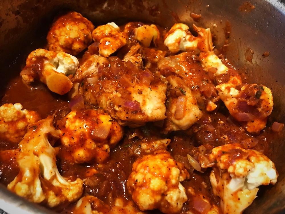 Making Greek Chicken Stew with Cauliflower and Olives
