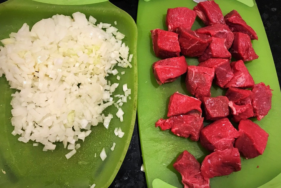 Chopped onion and cubed meat for Fasoliya