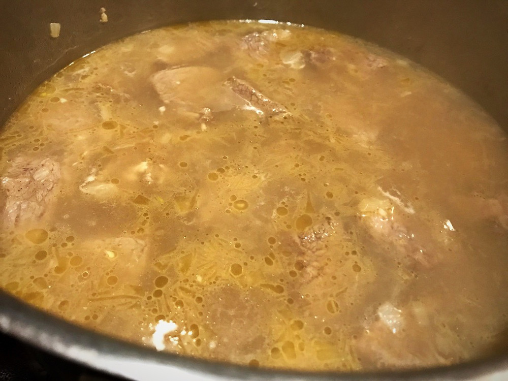 Add water just enough to cover the meat - Fasoliya