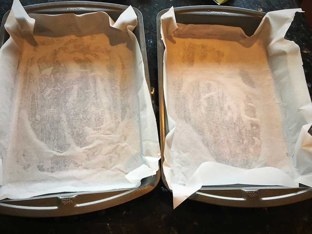 Lining the baking dishes with parchment paper for Kvæfjordkaka