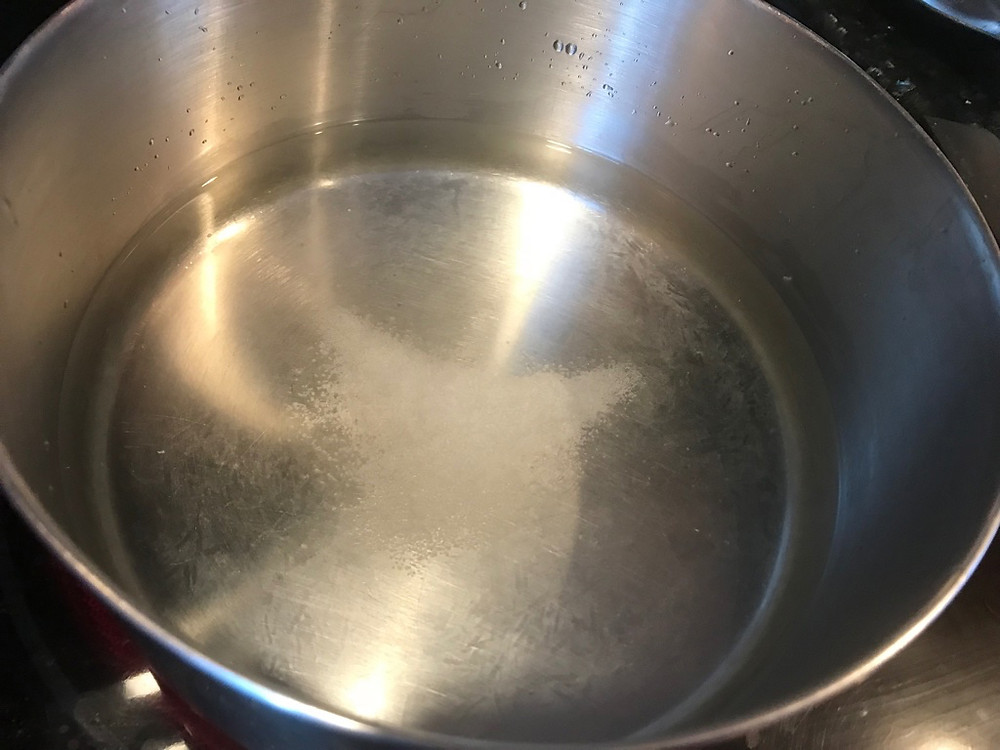 Boiling water for steaming of Cod