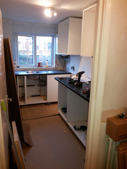 Fitting new cupboards and work top..