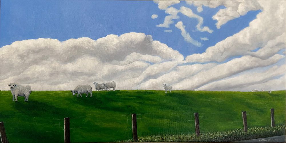 Big bold skies and the sheep meandering over the dike
