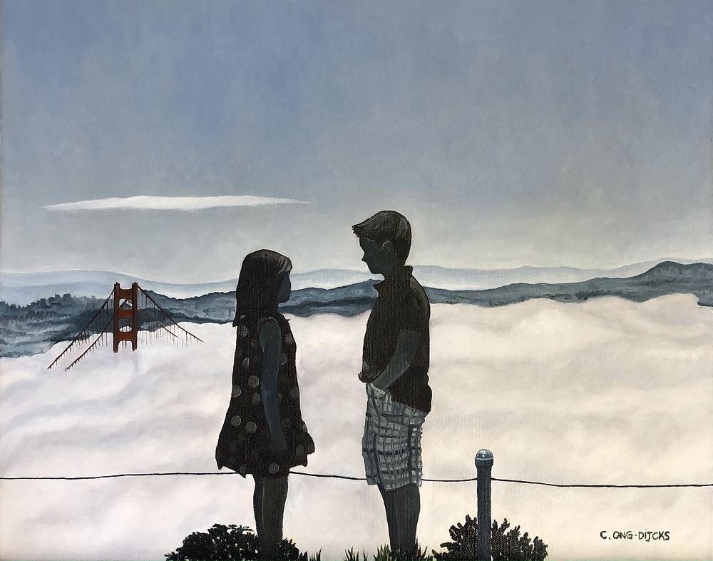 A boy and a girl, with the Golden Gate peeking through the famous fog