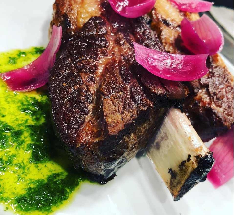 36 hour slow cooked short rib with chimichurri and pink pickled pearl onion petals