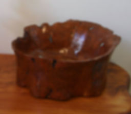 Black Cherry Burl Bowl Sculpture with turquoise inlay. Currently at Chumani Art Gallery Madrid, New Mexico.