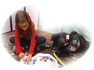 Blueberry Bear helping her library buddy read aloud.