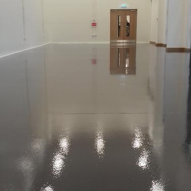 Showroom floor coated in epoxy. dark grey. Cheshire