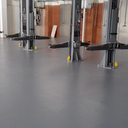 Polyurethane UV resistant coating installed for a garage workshop in Nursling