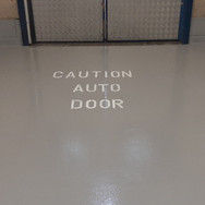 Safety writing in front of an automatic door
