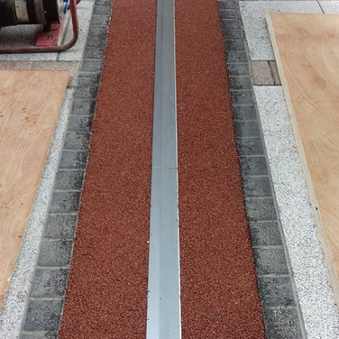 Resin bound stone installed in an expansion joint at Gunwharf Quays